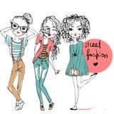 Cute fashion girls. 3 cute cartoon fashion girls Royalty Free Stock Photos