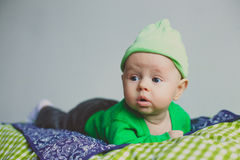 Cute fashion hipster baby in green hat Stock Photo