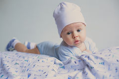 Cute fashion hipster baby in hat Stock Photos