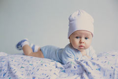 Cute fashion hipster baby in hat. Cute fashion hipster baby boy in hat looking seriously stock image