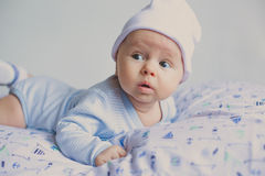 Cute fashion hipster baby in hat Royalty Free Stock Image