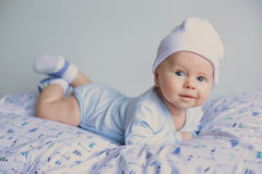 Cute fashion hipster baby in hat stock images