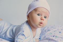 Cute fashion hipster baby in hat surprised Royalty Free Stock Photos