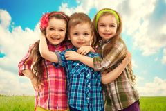 Cute fashion kids hugging each other. Royalty Free Stock Photography