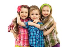 Cute fashion kids hugging each other stock photo