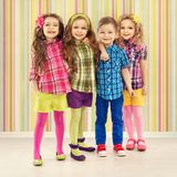 Cute fashion kids are standing together. Fashionable and friendship concept Stock Images