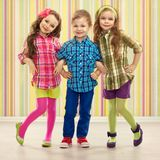 Cute fashion kids are standing together. Fashionable and friendship concept Stock Image