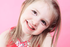 Cute fashion little doll girl in pink background Stock Image