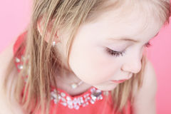 A cute fashion little doll girl in pink background Stock Image