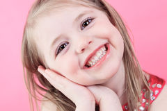 Cute fashion little doll girl in pink background Royalty Free Stock Image