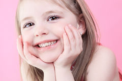 Cute fashion little doll girl in pink background Royalty Free Stock Photography