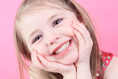 Cute fashion little doll girl in pink background Royalty Free Stock Photo