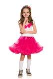 Cute fashion little girl imagines. A cute fashion little girl imagines against the white background royalty free stock photos