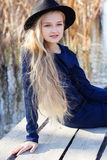 Cute fashion little girl is resting near lake Royalty Free Stock Photos