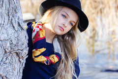 Cute fashion little girl is resting near lake Stock Image