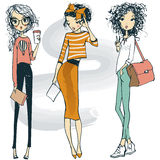 Cute fashion sketched girls. Three cartoon cute fashion sketched hipster girls Royalty Free Stock Image