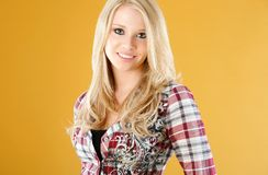 Cute fashion teen. Teen model poses wearing tank top with unbuttoned shirt and jeans Royalty Free Stock Photos