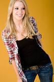 Cute fashion teen. Teen model poses wearing tank top with unbuttoned shirt and jeans Stock Photography