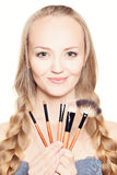Cute fashion woman and makeup brushes Stock Image