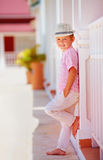 Cute fashionable boy, kid posing on summer street Stock Photography