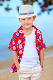 Cute fashionable boy on summer beach Stock Photos
