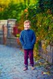 Cute fashionable boy walking on autumn street Royalty Free Stock Photos