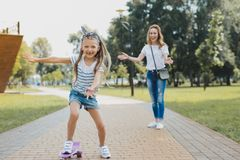 Cute fashionable girl feeling extremely cheerful and happy royalty free stock photos