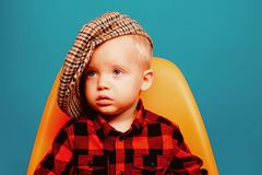 Cute and fashionable. Small baby in fashionable wear. Small child. Boy child with fashion look. Fashion boy. Adorable. Fashionist. Childrens fashion trends stock photo