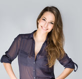Cute fashionable young brunette. Portrait of cute fashionable young brunette woman in dark blue shirt Stock Image
