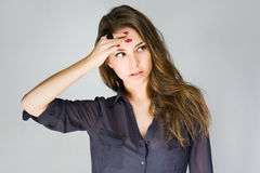 Cute fashionable young brunette. Royalty Free Stock Photos