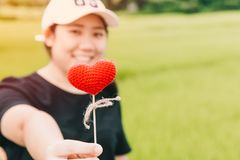 Cute fat girl teen giving heart love concept. With space for text Stock Photo