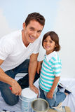 Cute father and his son decorating their Royalty Free Stock Image