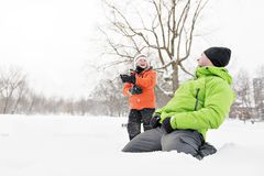 A cute Father And Son In Snowy Landscape royalty free stock photography