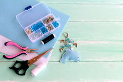 Cute felt Dolphin keyring with beads. Blue felt sea animal keychain. Materials and tools set to create crafts Royalty Free Stock Photography