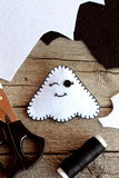 Cute felt Halloween ghost toy, scissors, black thread, scraps of felt on old wooden background. Supplies for ghost toy sewing Stock Photos
