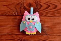Cute felt owl with a flower Royalty Free Stock Images