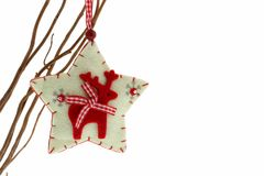 Cute felt reindeer Christmas decoration. Isolated on white royalty free stock photos
