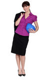 Cute female archtect. Standing in studio Royalty Free Stock Image