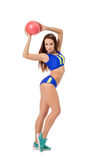 Cute female athlete posing with ball at camera Royalty Free Stock Image