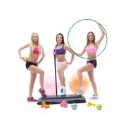 Cute female athletes posing with sports equipment Royalty Free Stock Photo