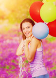 Cute female with balloons Stock Images