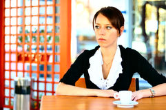 Cute female at the cafe drinking coffee Royalty Free Stock Images