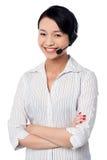 Cute female call centre executive. Confident female call centre executive Stock Photos