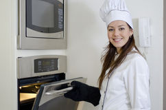 Cute female chef baking Royalty Free Stock Images
