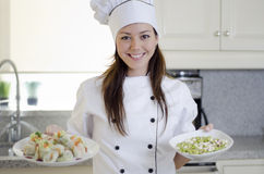 Cute female chef in the kitchen Stock Photos