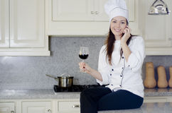 Cute female chef taking a break Stock Images