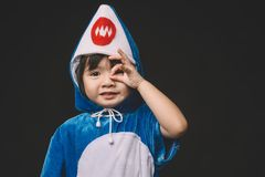 Child portrait with baby shark costume in studio royalty free stock photos