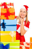 Cute female Christmas Santa with gifts Royalty Free Stock Images
