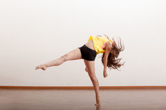 Cute female dancer in a studio Stock Images