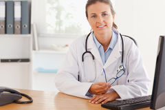 Cute female doctor posing with glasses Stock Images